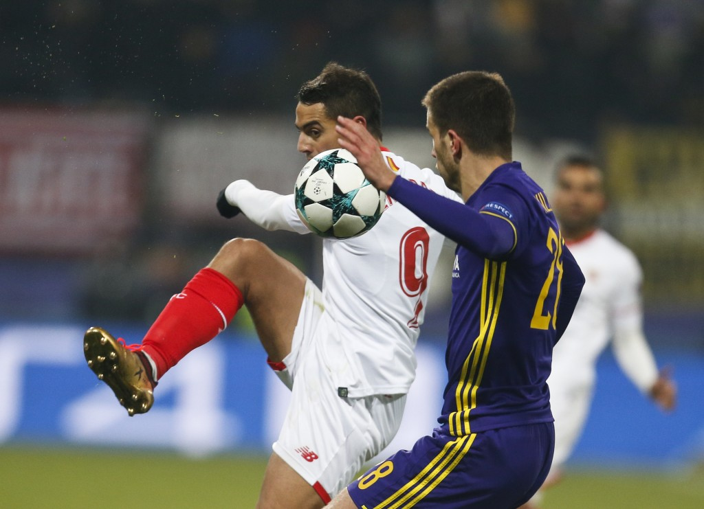 Sevilla's Wissam Ben Yedder fights for the ball with Maribor's Mitja Viler during the group E Champions League soccer match between Maribor and Sevill