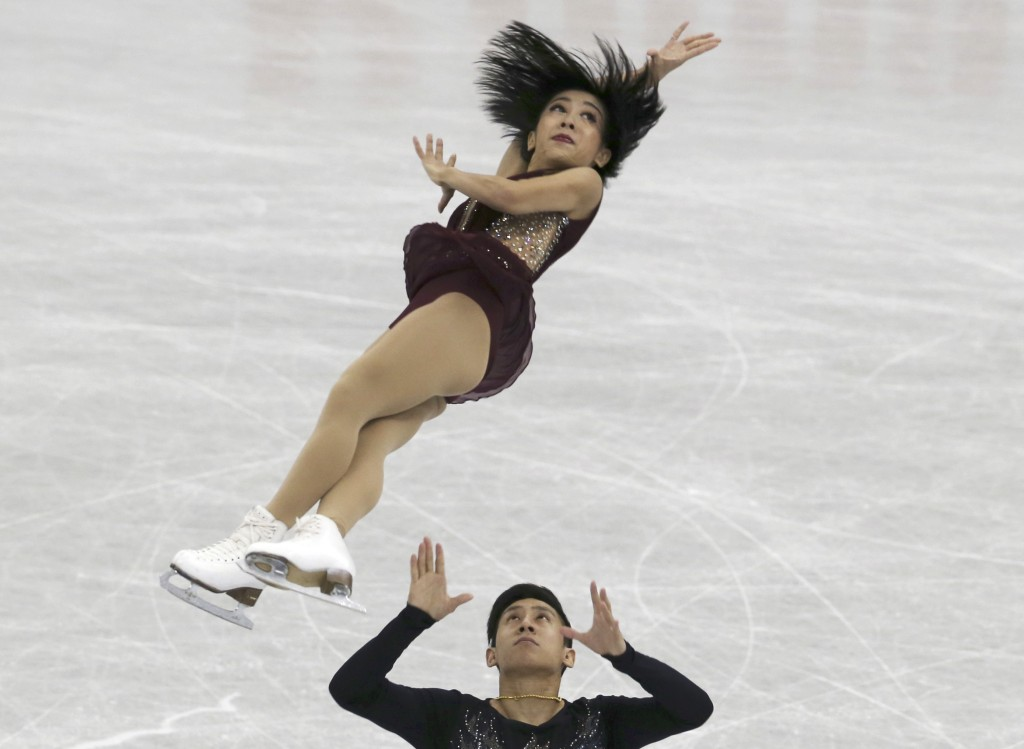 Sui Wenjing and Han Cong of China perform during a Pairs Short Program of the ISU Grand Prix of Figure Skating Final in Nagoya central Japan Thursday,