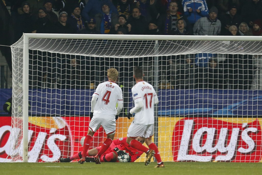 Sevilla's goalkeeper Sergio Rico grabs the ball after a shot on goal attempt during the group E Champions League soccer match between Maribor and Sevi