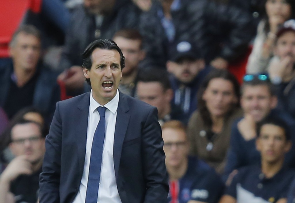 FILE - In this Saturday, Sept. 30, 2017 file photo, PSG's head coach Unai Emery reacts during a French League One soccer match Paris-Saint-Germain aga
