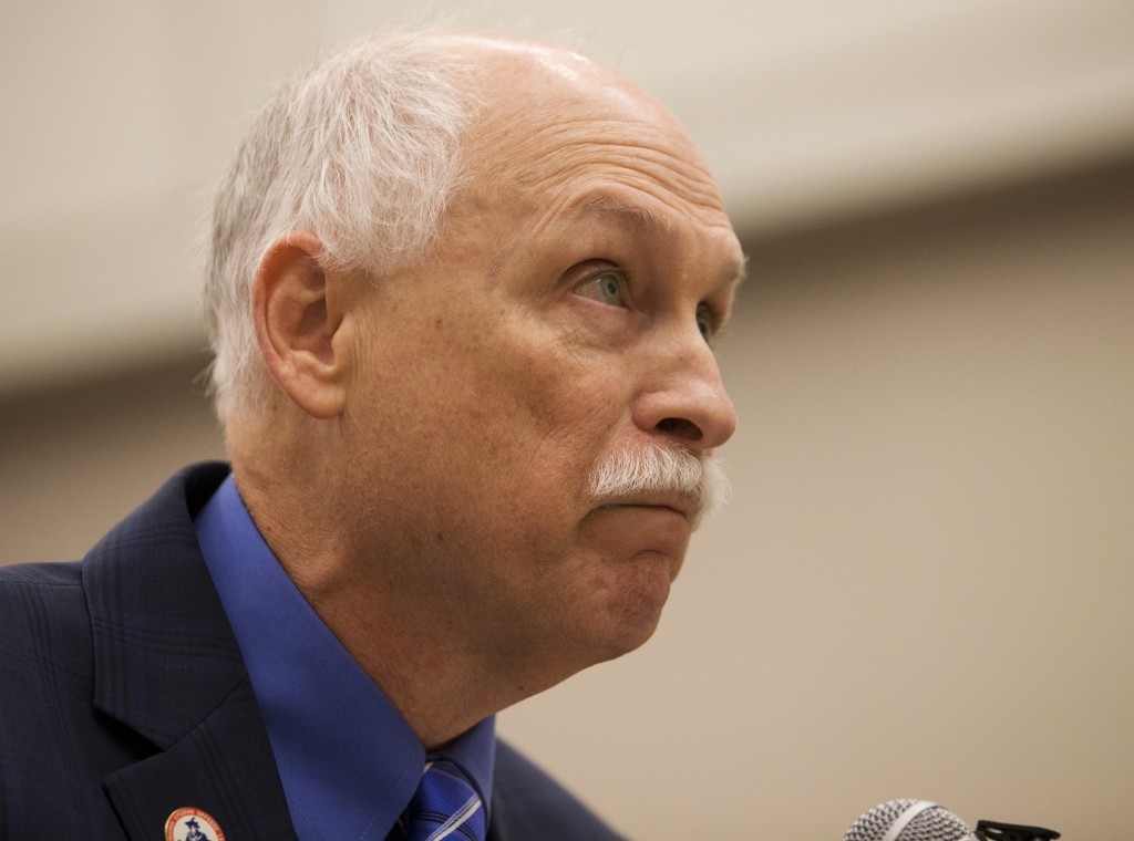 FILE - This Aug. 31, 2016 file photo shows Phil Van Cleave, president of the pro-gun Virginia Citizens Defense League, during a public hearing at the