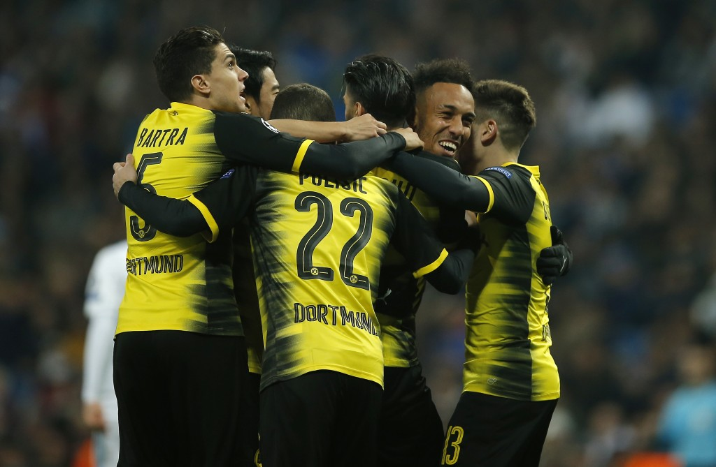 Dortmund's Pierre-Emerick Aubameyang is celebrated by teammates after he scored his second goal during the Champions League Group H soccer match betwe