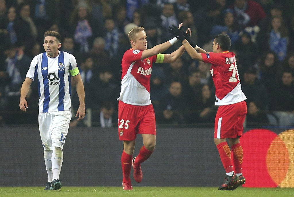 Monaco's Kamil Glik, center, celebrates after scoring his side's first goal from the penalty spot during the Champions League group G soccer match bet
