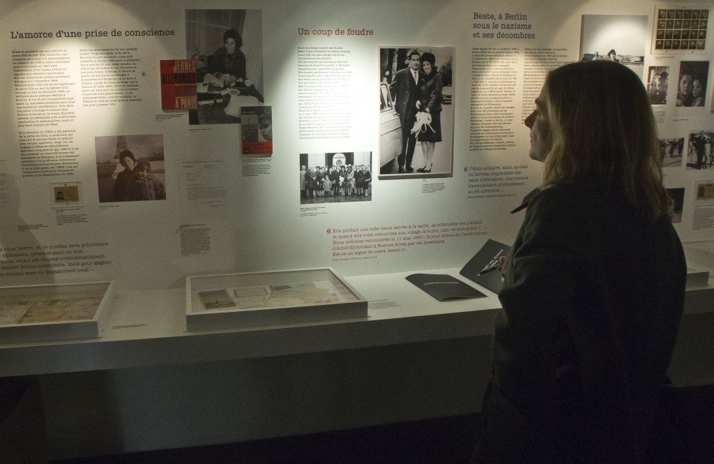 In this photo taken on Tuesday, Dec. 5, 2017, a member of the media visits the exhibition of Beate and Serge Klarsfeld during a media presentation at