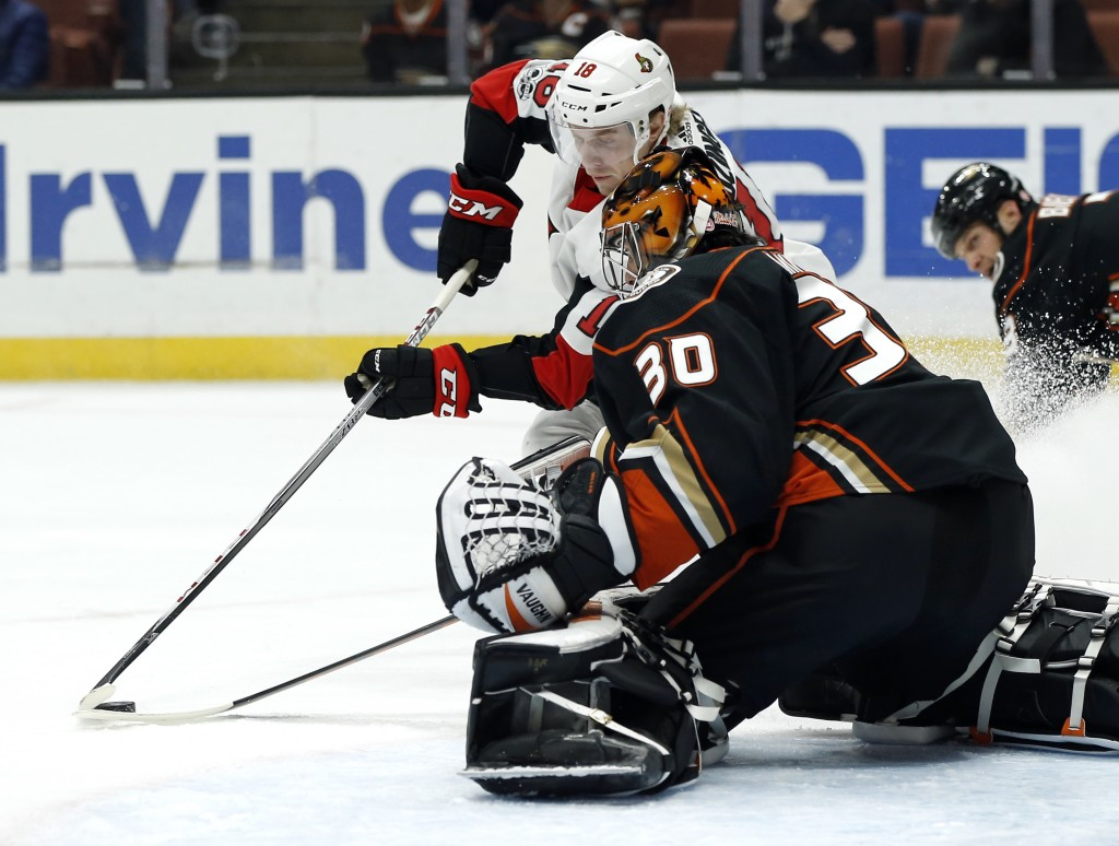 Anaheim Ducks goalie Ryan Miller (30) stops a shot by Ottawa Senators left wing Ryan Dzingel (18) during the first period of an NHL hockey game in Ana