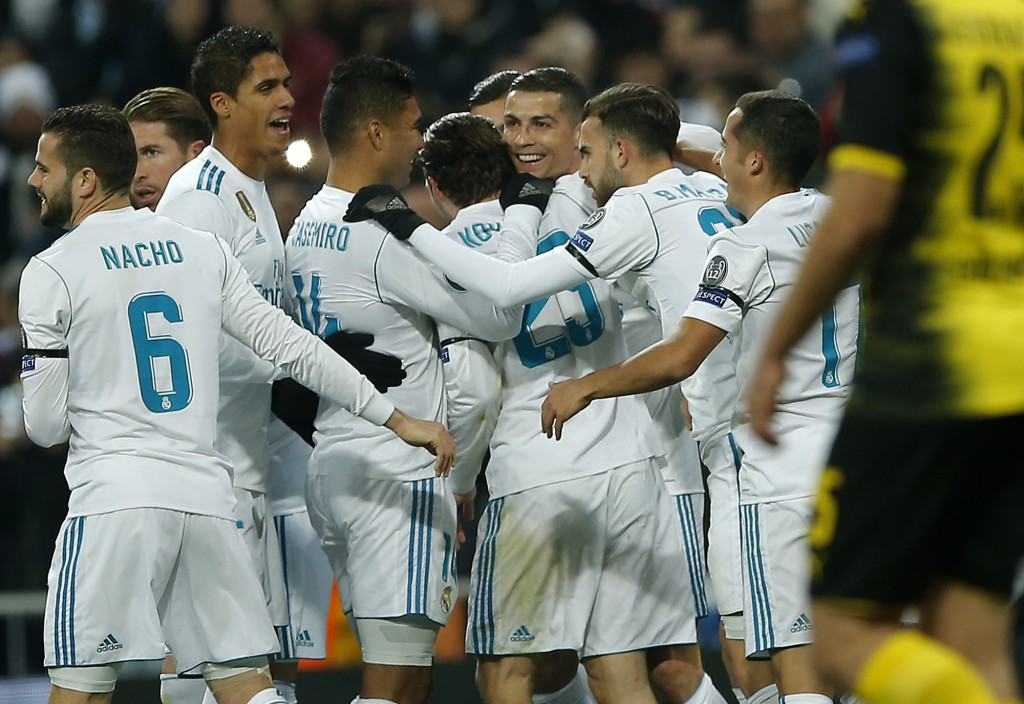 Real Madrid's Cristiano Ronaldo, center, is celebrated by his team after he scored his side's second goal during the Champions League Group H soccer m