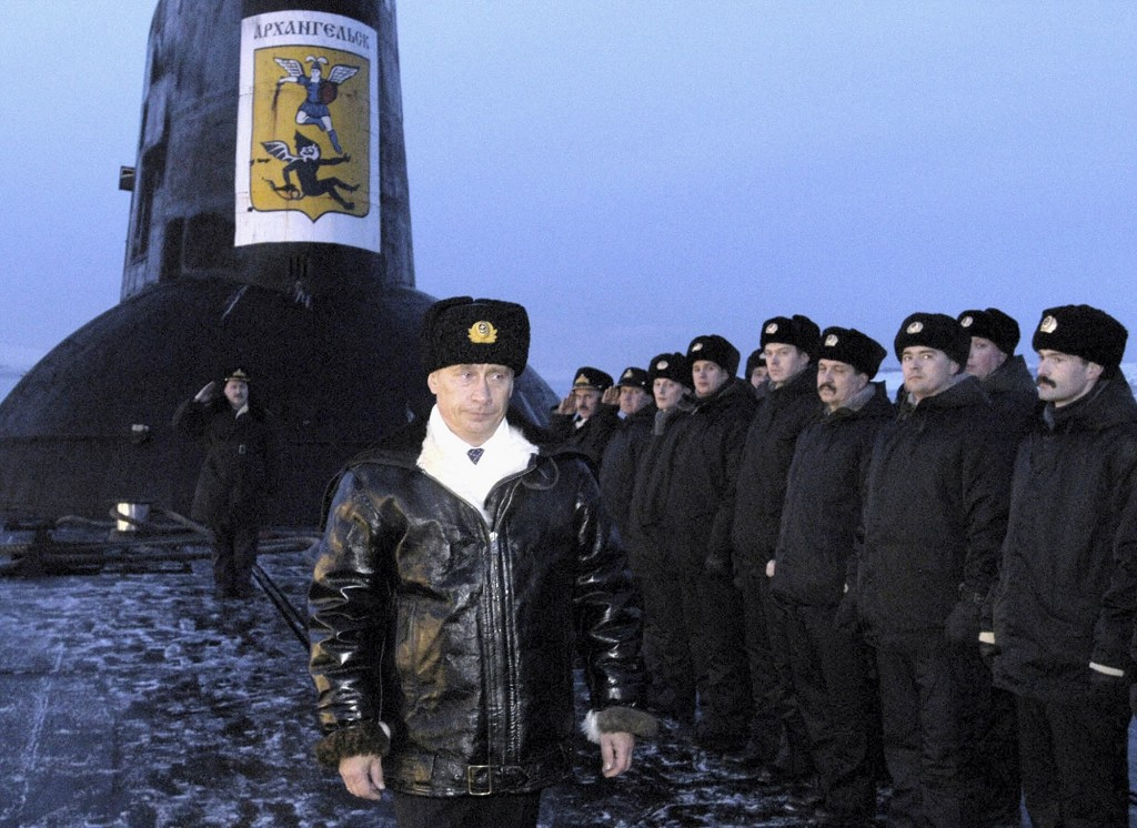 FILE- In this file photo taken on Tuesday, Feb. 17, 2004, Russian President Vladimir Putin thanks the crew of the Arkhangelsk nuclear submarine in the