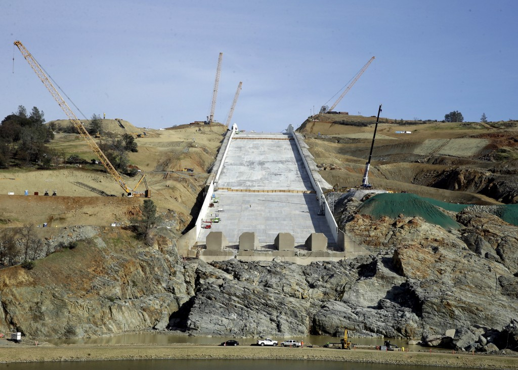 FILE - In this Nov. 30, 2017, file photo, work continues on the Oroville Dam spillway in Oroville, Calif. California water officials plan to update a