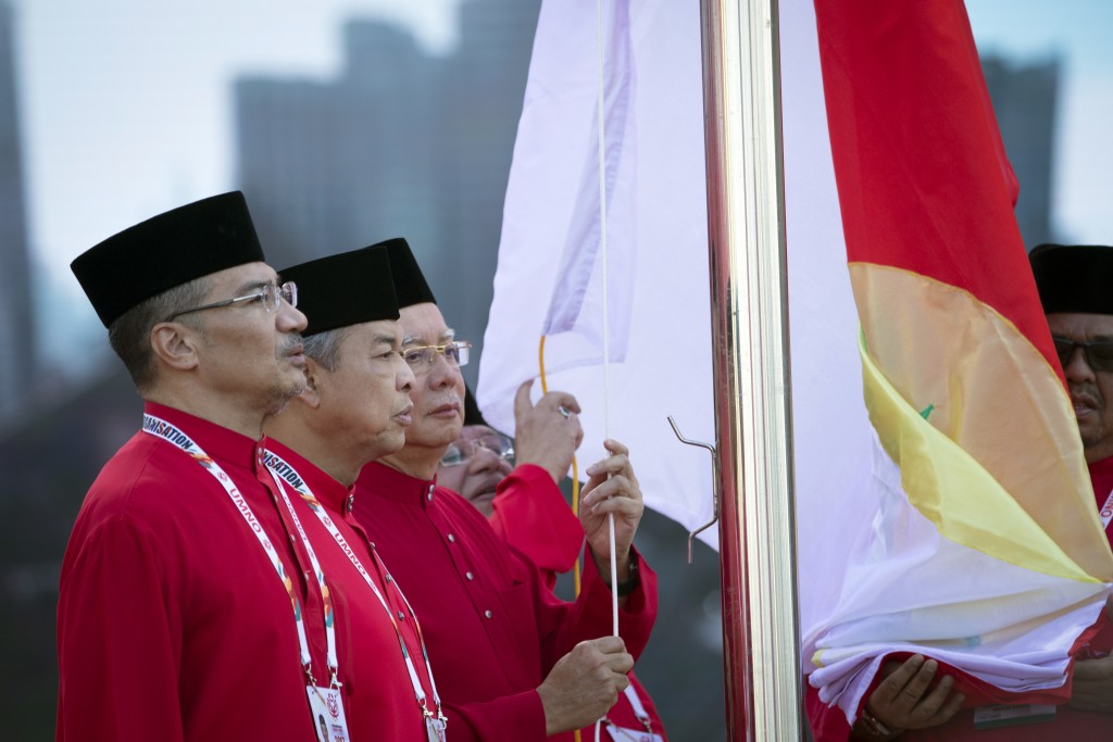 United Malays National Organisation (UMNO) party President and Malaysian Prime Minister Najib Razak, third left, Deputy President and Deputy Prime Min