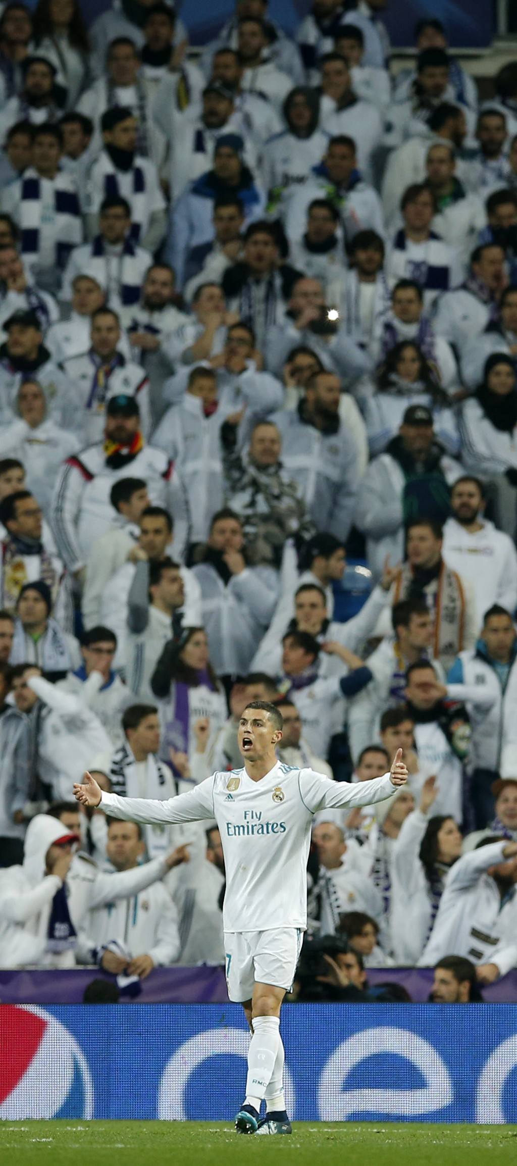 Real Madrid's Cristiano Ronaldo reacts in front of supporters during the Champions League Group H soccer match between Real Madrid and Borussia Dortmu