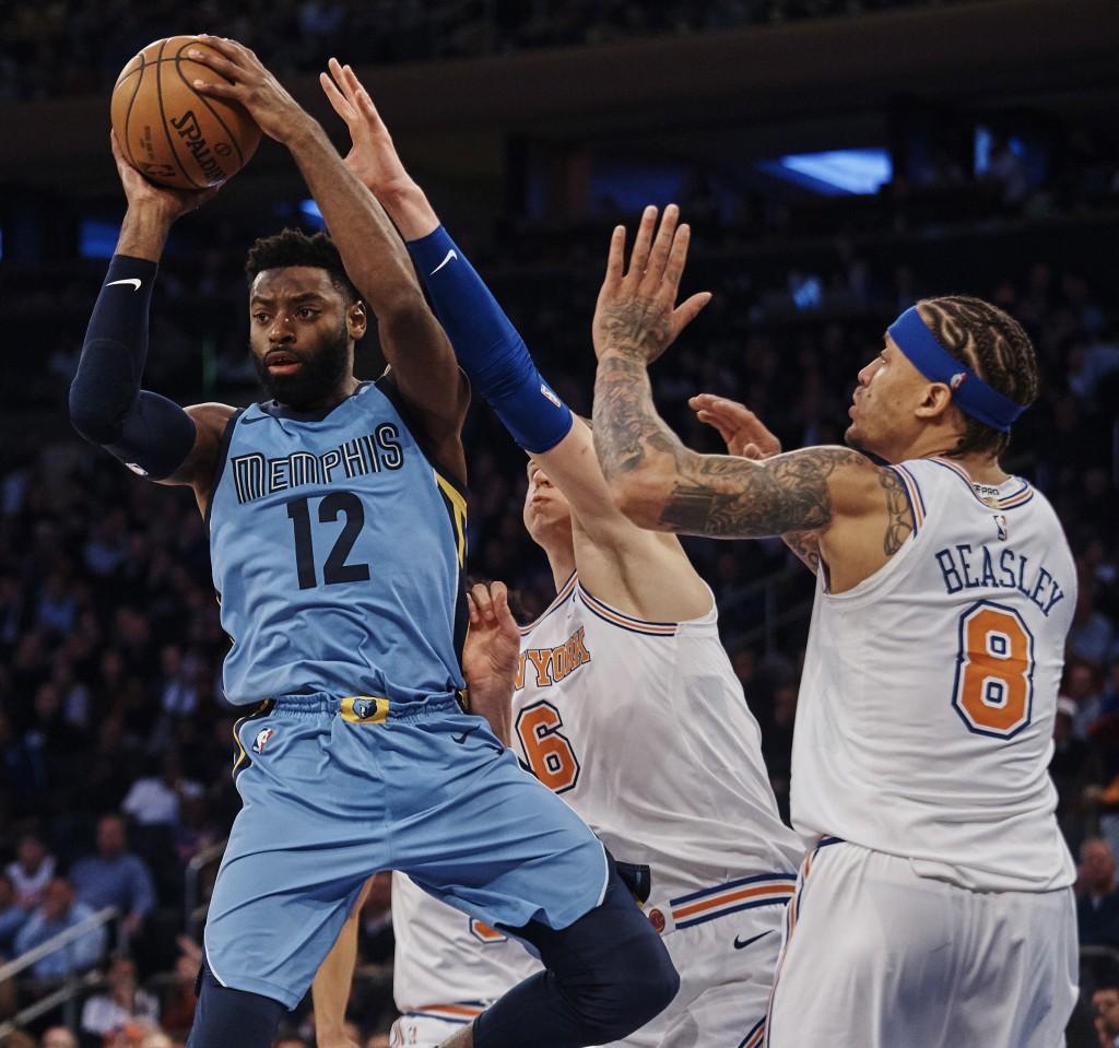 Memphis Grizzlies' Tyreke Evans (12) looks to pass the ball next to New York Knicks' Michael Beasley (8) during the first half of an NBA basketball ga