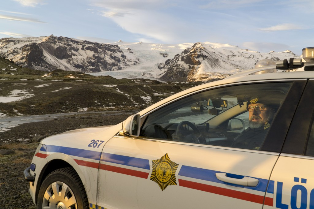 Police inspector Adolf Arnason poses for a photo at the foot of Oraefajokull volcano in Iceland, Thursday, Nov. 30, 2017. The Oraefajokull volcano, do