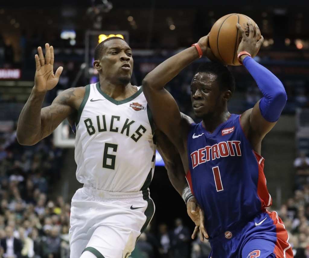 Detroit Pistons' Reggie Jackson tries to drive past Milwaukee Bucks' Eric Bledsoe during the first half of an NBA basketball game Wednesday, Dec. 6, 2