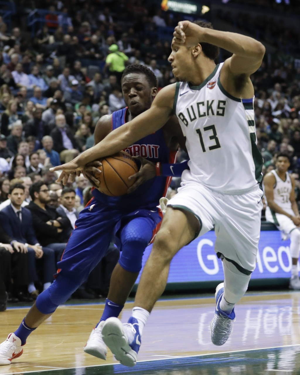 Detroit Pistons' Reggie Jackson tries to drive past Milwaukee Bucks' Malcolm Brogdon during the first half of an NBA basketball game Wednesday, Dec. 6