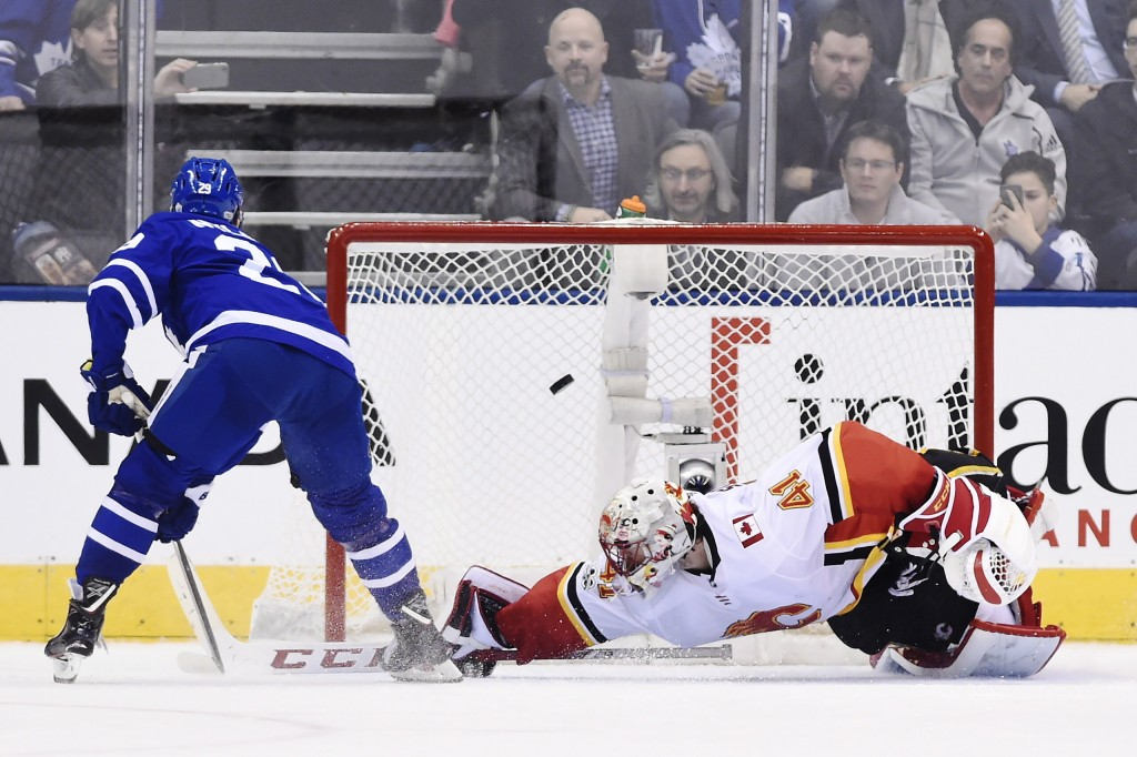 Toronto Maple Leafs center William Nylander (29) scores on Calgary Flames goalie Mike Smith (41) during the shootout in an NHL hockey game, Wednesday,