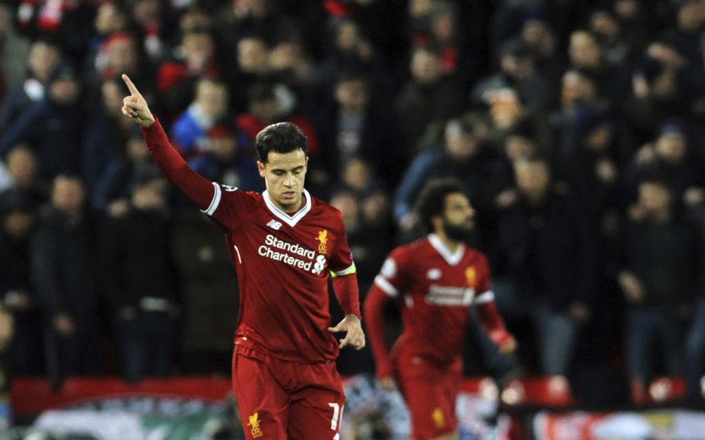 Liverpool's Philippe Coutinho, left, celebrates after scoring his side's second goal during the Champions League Group E soccer match between Liverpoo
