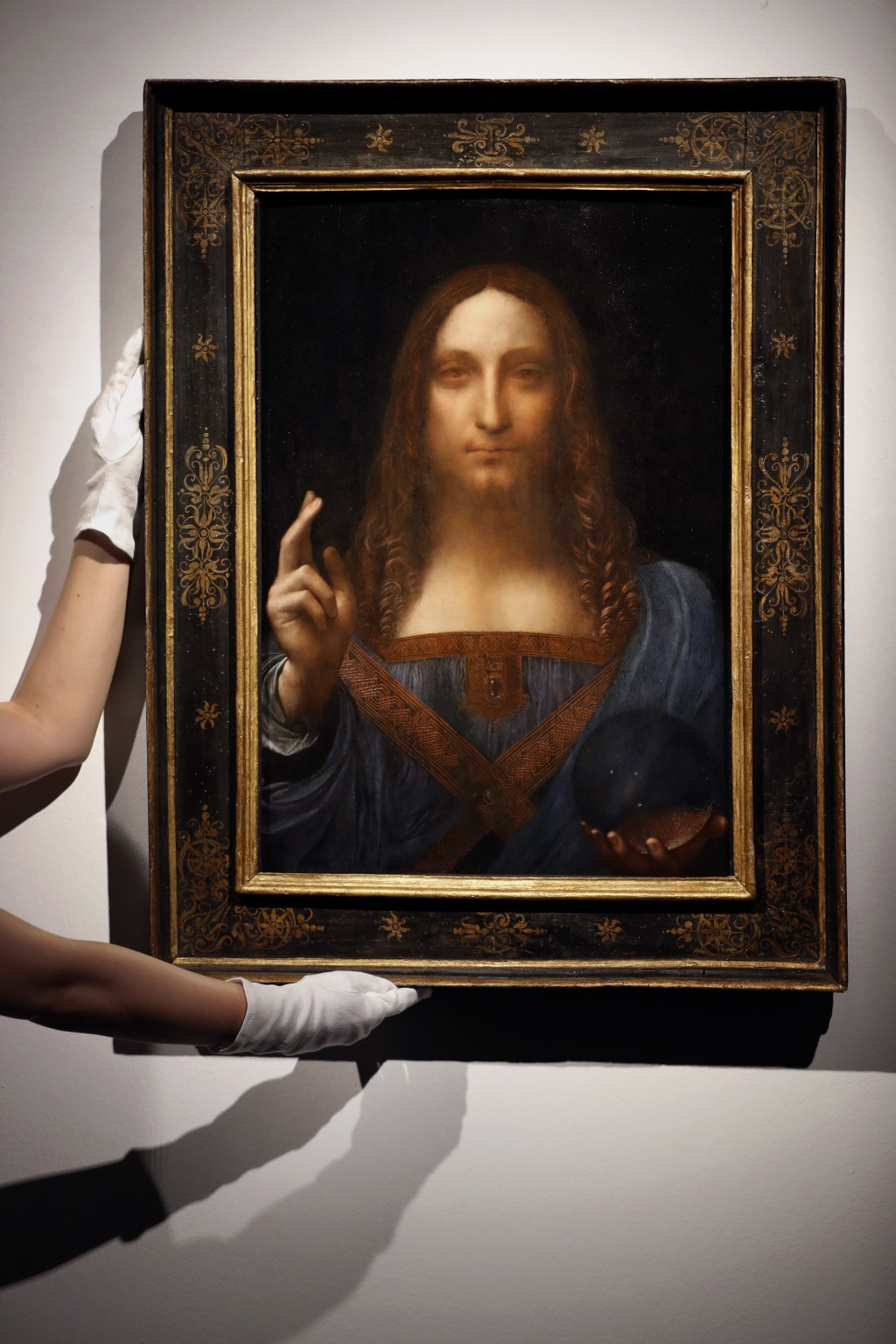 """FILE- This Oct. 24, 2017, file photo shows Leonardo da Vinci's """"Salvator Mundi"""" on display at Christie's auction rooms in London. The rare painting of"""