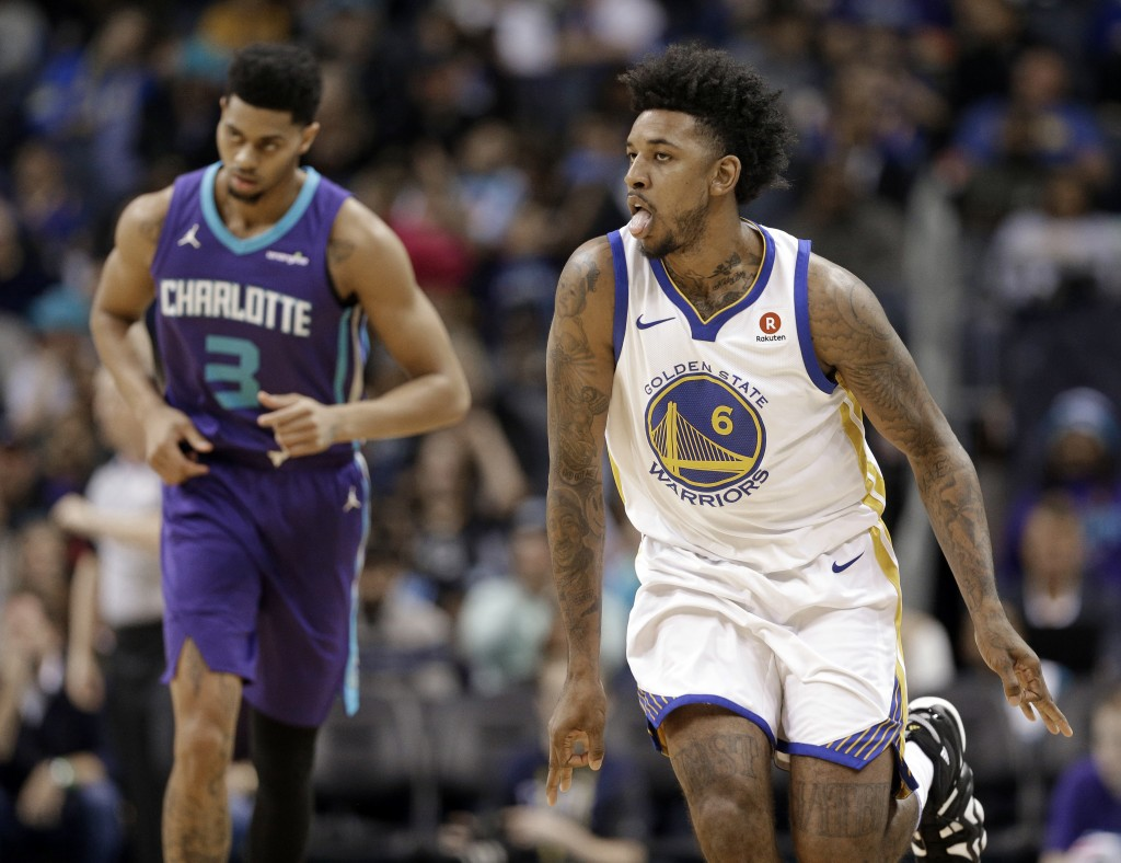 Golden State Warriors' Nick Young (6) reacts to making a basket against Charlotte Hornets' Jeremy Lamb (3) during the first half of an NBA basketball