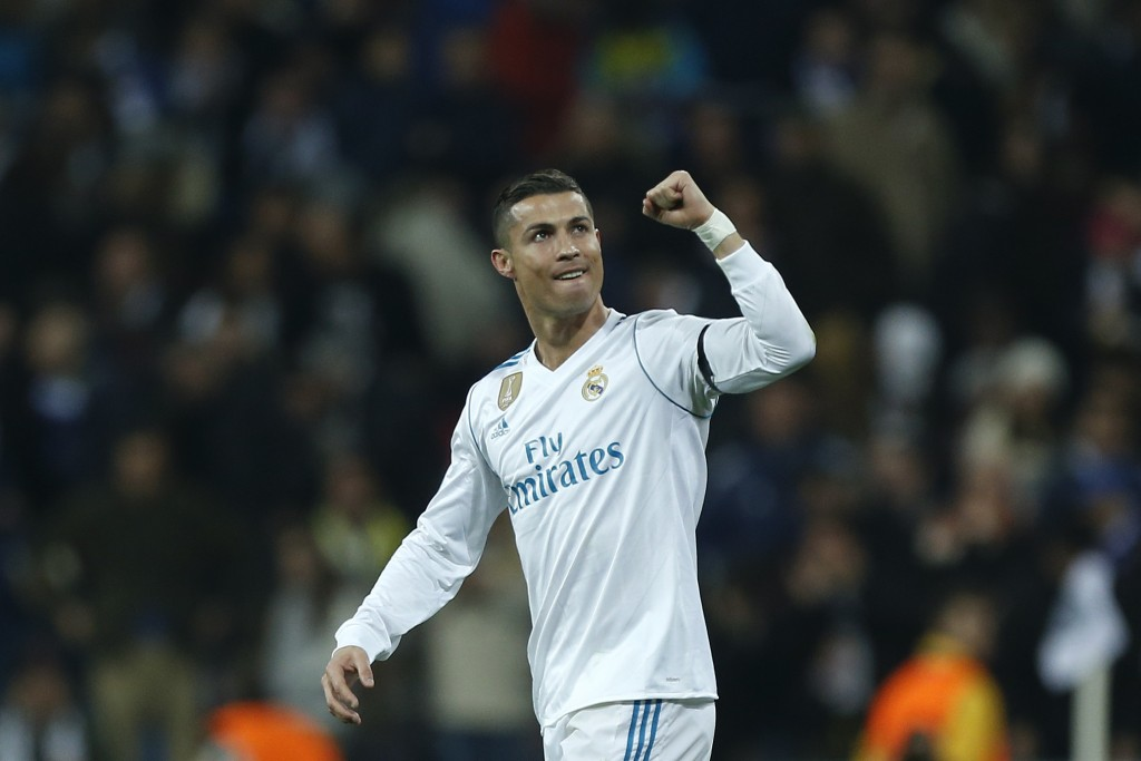 Real Madrid's Cristiano Ronaldo celebrates after scoring his side's second goal during the Champions League Group H soccer match between Real Madrid a