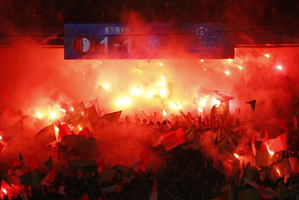 Feyenoord's fans light up flares during a Champions League Group F soccer match between Feyenoord and Napoli at the Kuip stadium in Rotterdam, Netherl