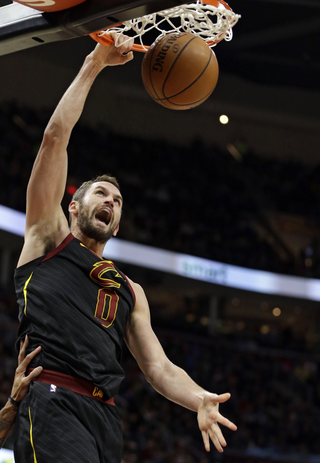 Cleveland Cavaliers' Kevin Love (0) dunks the ball against the Sacramento Kings in the first half of an NBA basketball game, Wednesday, Dec. 6, 2017,