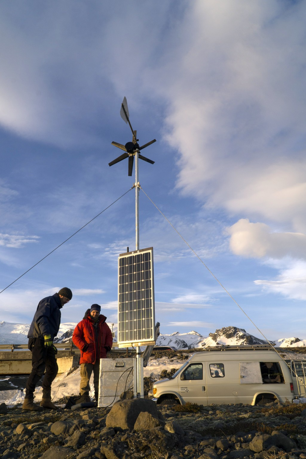 Scientists from the Icelandic Meteorological Office install monitoring equipment at the rivers flowing down from the glaciers on Oraefajokull volcano