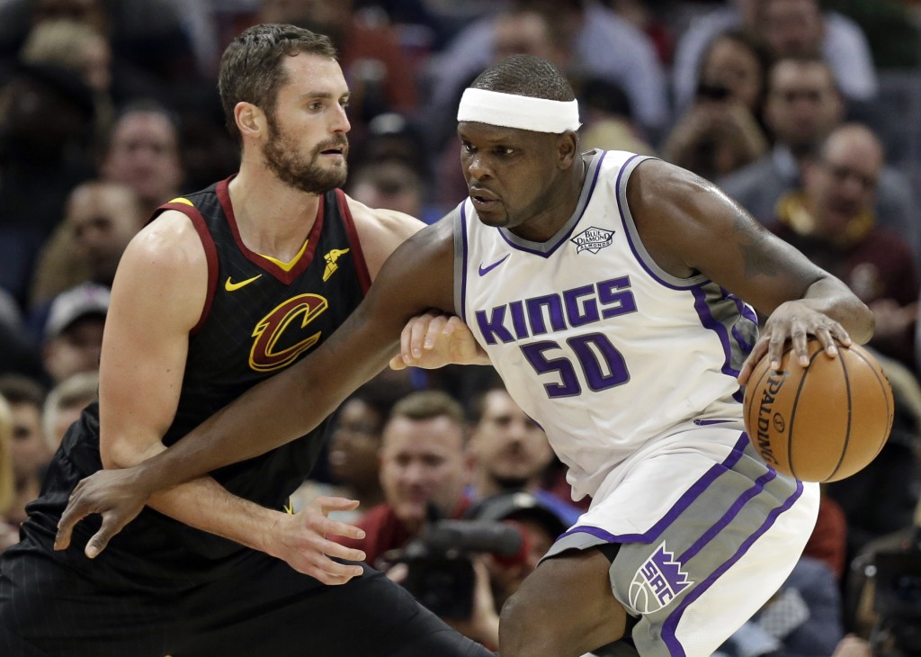 Sacramento Kings' Zach Randolph, right, drives past Cleveland Cavaliers' Kevin Love in the first half of an NBA basketball game, Wednesday, Dec. 6, 20