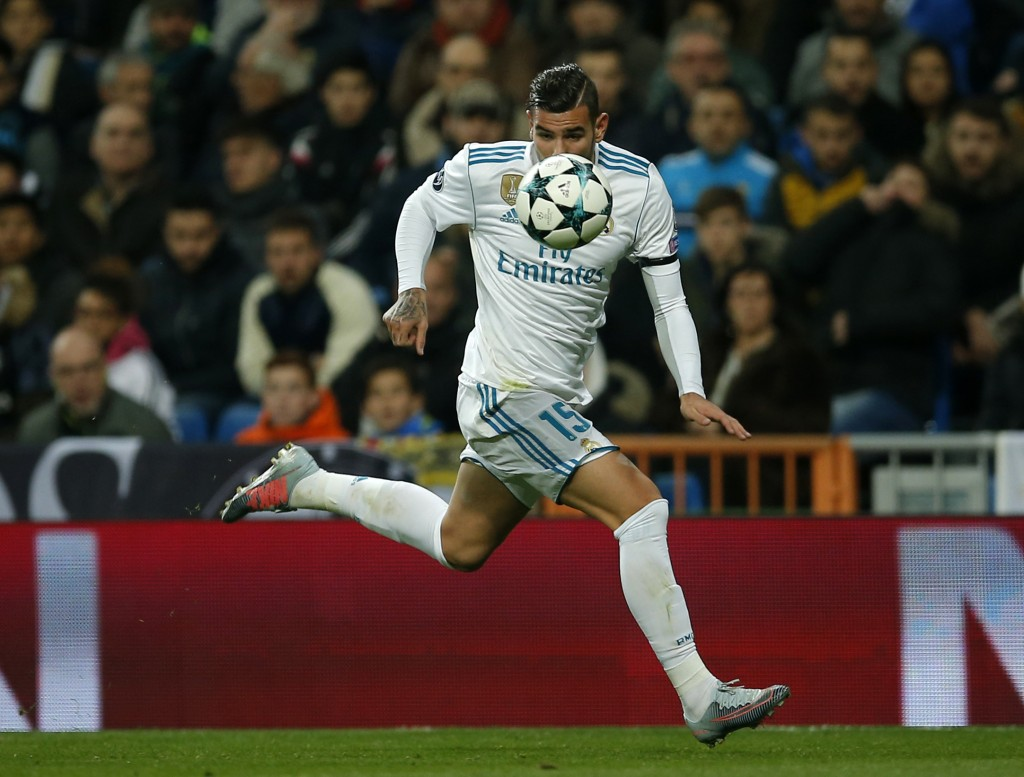 Real Madrid's Theo Hernandez runs for the ball during the Champions League Group H soccer match between Real Madrid and Borussia Dortmund at the Santi
