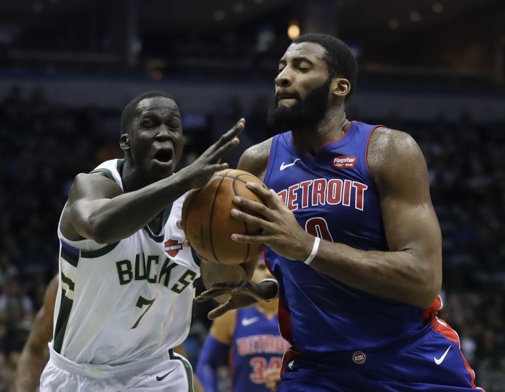 Milwaukee Bucks' Thon Maker fouls Detroit Pistons' Andre Drummond during the first half of an NBA basketball game Wednesday, Dec. 6, 2017, in Milwauke