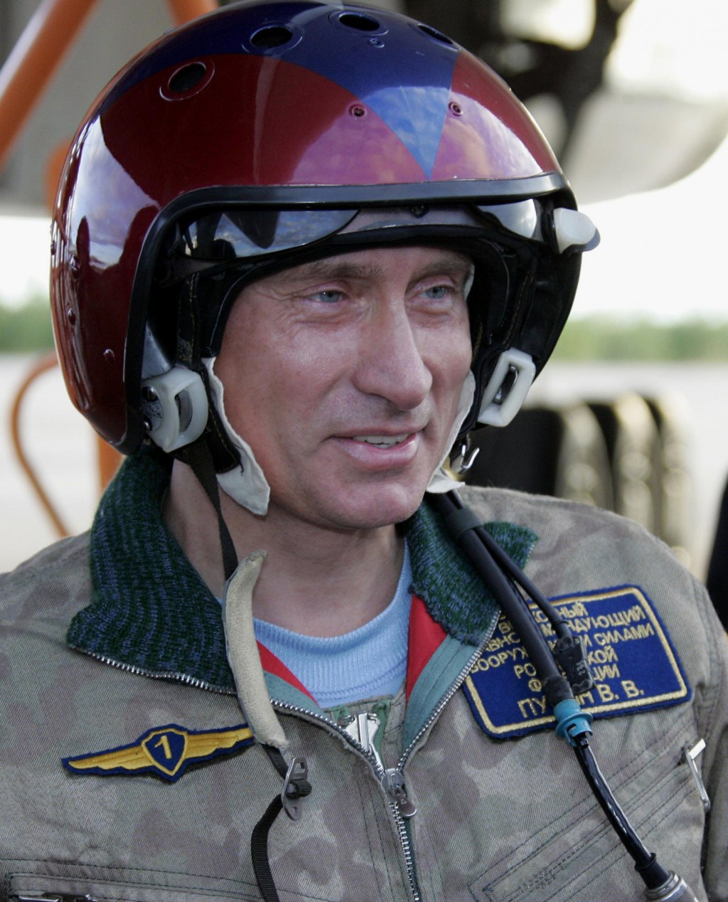 FILE - In this file pool photo taken on Wednesday, Aug. 17, 2005, Russian President Vladimir Putin smiles at an airfield near the northern city of Mur