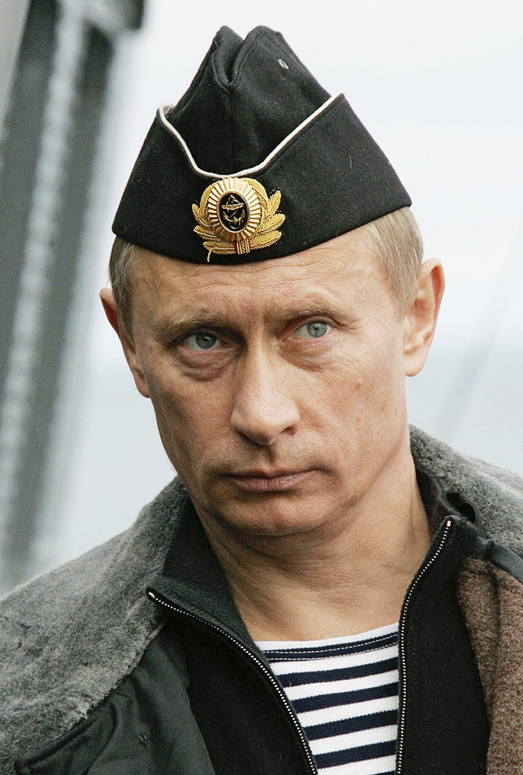 FILE- In this file photo taken on Wednesday, Aug. 17, 2005, Russian President Vladimir Putin, wearing sailor's uniform, observes naval manoeuvres of R