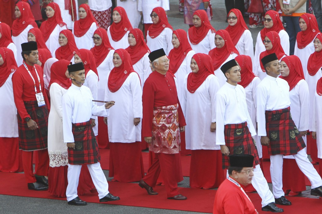 United Malays National Organisation (UMNO) party President and Malaysian Prime Minister Najib Razak, center, inspects a ceremonial guard of honor duri