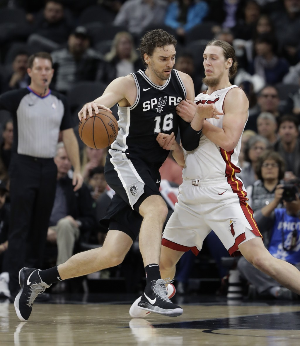 San Antonio Spurs center Pau Gasol (16) drives around Miami Heat center Kelly Olynyk during the first half of an NBA basketball game Wednesday, Dec. 6