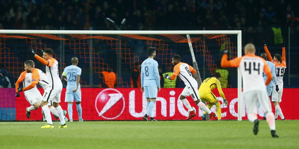 Shakhtar Donetsk players celebrate after scoring their side's opening goal during the Champions League group F soccer match between Manchester City an