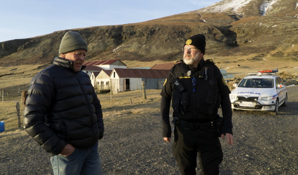 Police inspector Adolf Arnason talks with a local farmer living at the foot of Oraefajokull volcano in Iceland, Thursday, Nov. 30, 2017. The Oraefajok