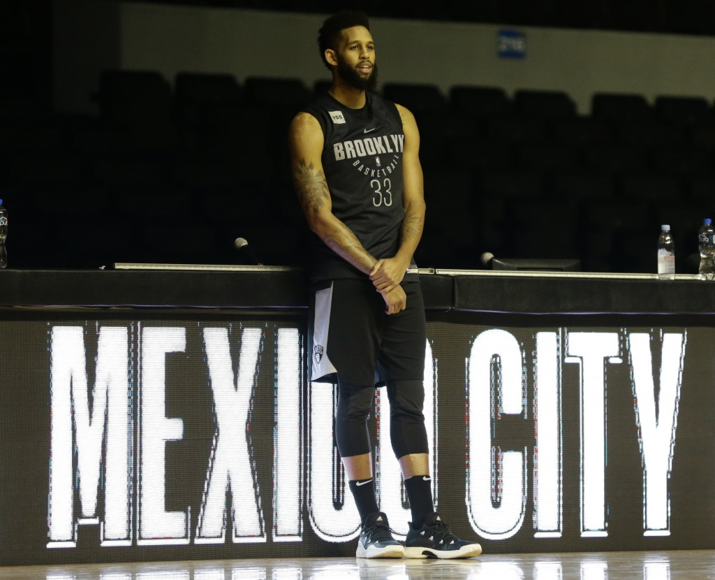 Allen Crabbe of the Brooklyn Nets looks on from the side of the court as a training session wraps up, at the Mexico City Arena in Mexico City, Wednesd