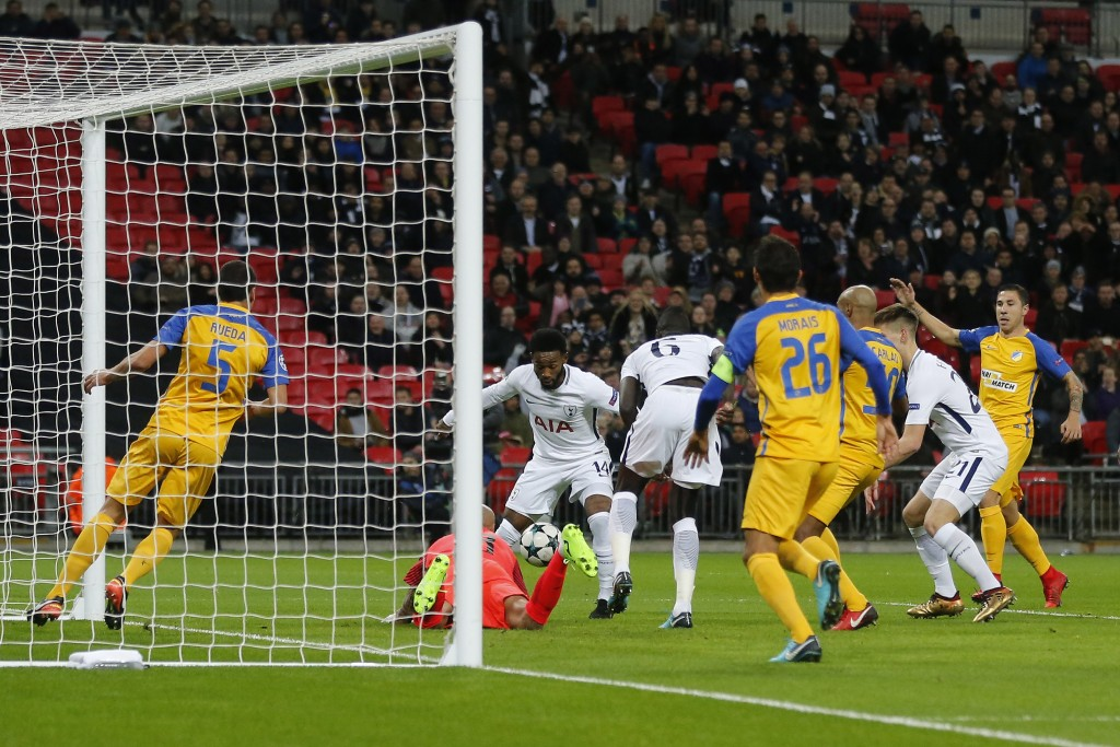 Tottenham's Georges-Kevin N'koudou, center, try to score by APOEL Nicosia goalkeeper Nauzet Parez during the Champions League Group H soccer match bet