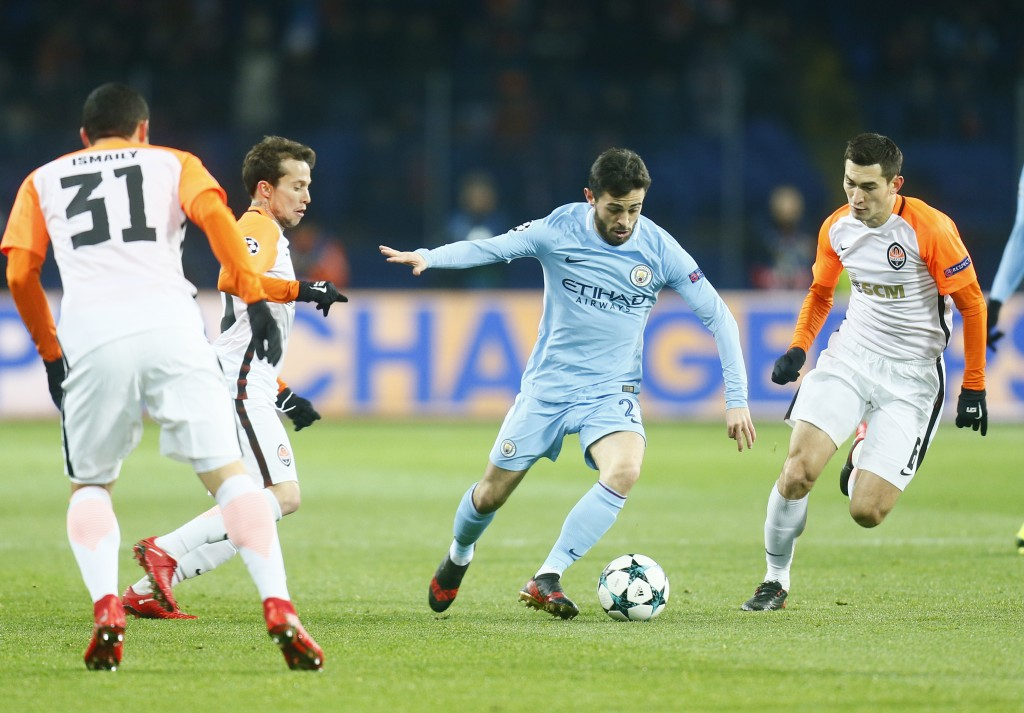 Manchester City's Bernardo Silva, center, controls the ball with Shakhtar's Taras Stepanenko, right, during the Champions League group F soccer match
