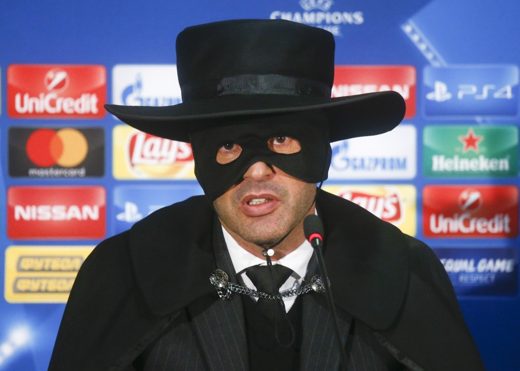 Shakthtar coach Paulo Fonseca, dressed as Zorro attends a press conference after victory for his team in the Champions League group F soccer match bet