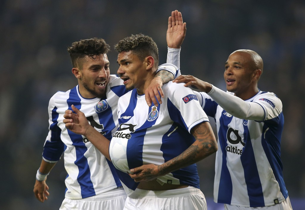 Porto's Soares, center, celebrates with Alex Telles, left, and Yacine Brahimi after scoring his side's fifth goal during the Champions League group G
