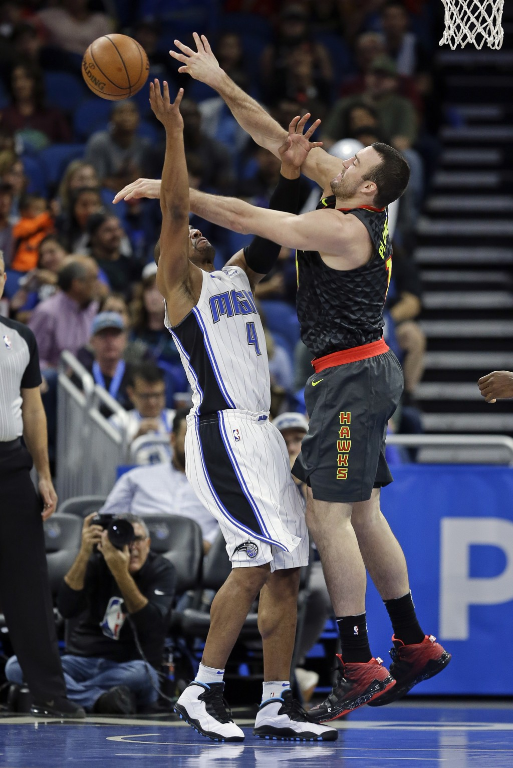 Orlando Magic's Arron Afflalo (4) battles Atlanta Hawks' Miles Plumlee, right, for a rebound during the first half of an NBA basketball game, Wednesda