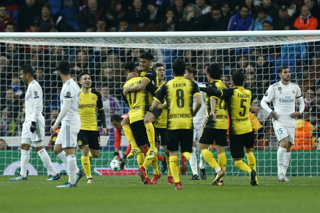 Dortmund players celebrate after Pierre-Emerick Aubameyang (17) scored his side's second goal during the Champions League Group H soccer match between