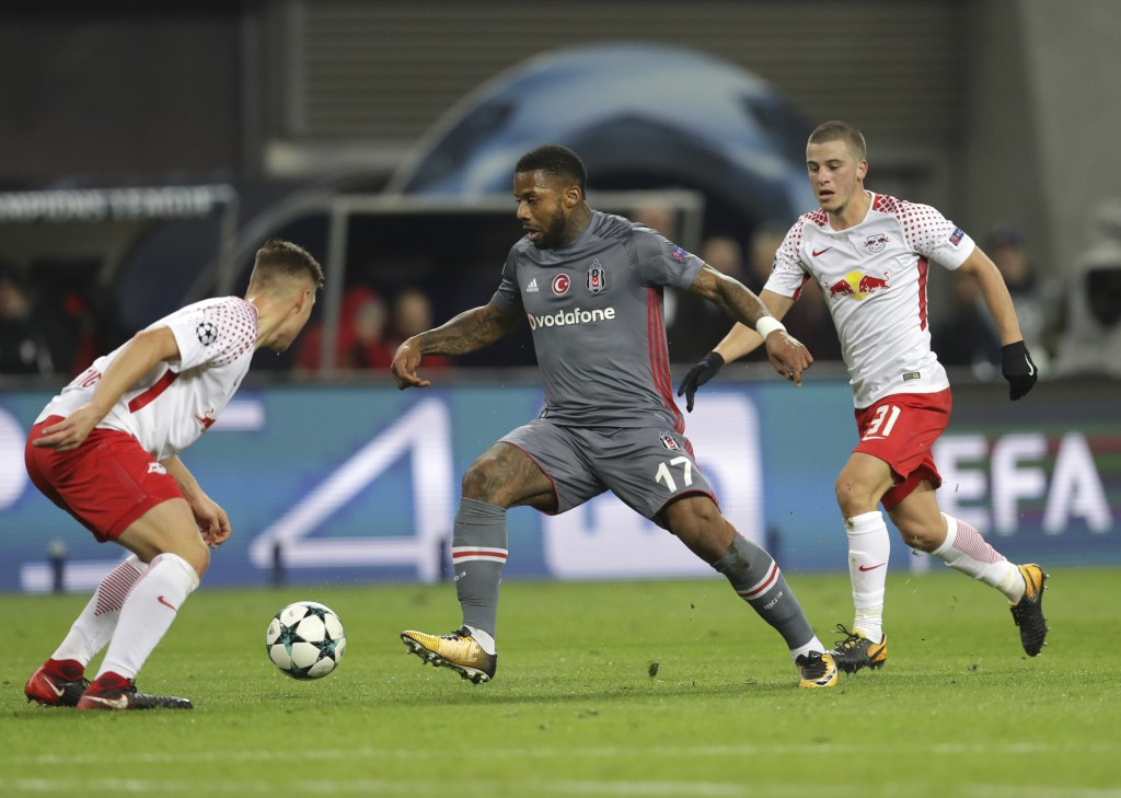 Besiktas' Jeremain Lens, center, goes past Leipzig's Willi Orban, left, and Diego Demme during the Champions League Group G soccer match between RB Le