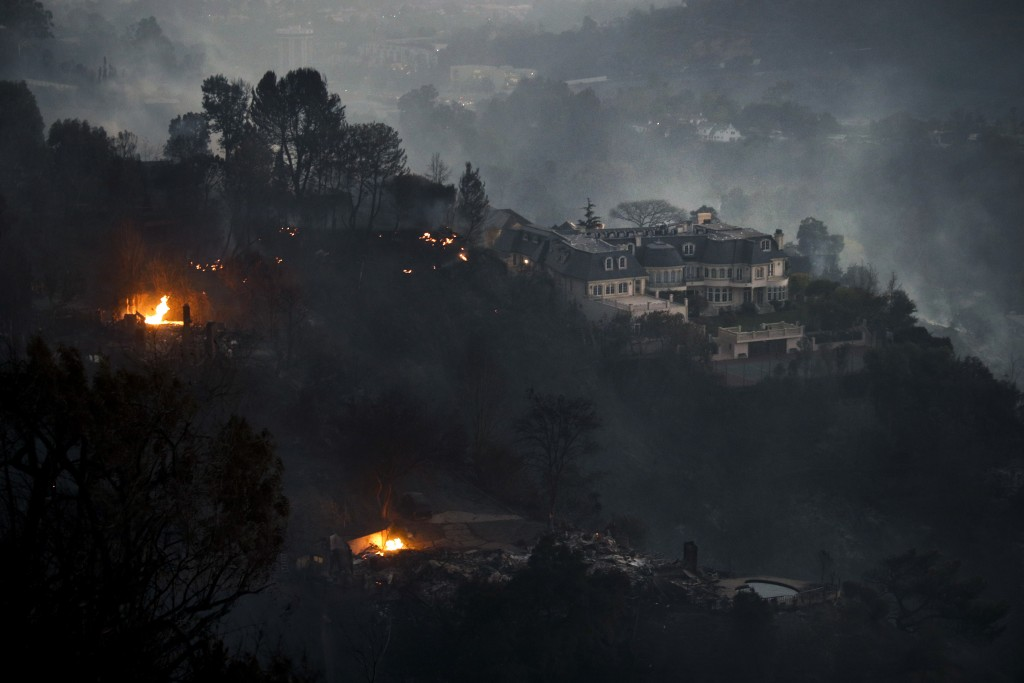 A mansion that survived a wildfire sits on a hilltop in the Bel Air district of Los Angeles Wednesday, Dec. 6, 2017. A dangerous new wildfire erupted