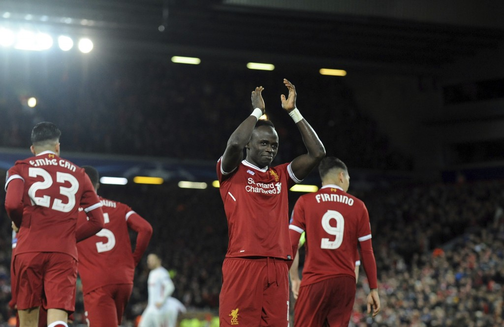 Liverpool's Sadio Mane, center, celebrates after scoring his side's fourth goal during the Champions League Group E soccer match between Liverpool and