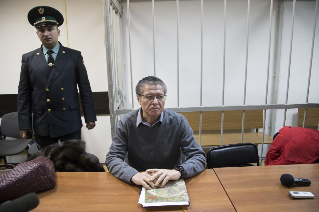 Former Russian Economic Development Minister Alexei Ulyukayev waits for a hearing at a court in Moscow, Russia, Thursday, Dec. 7, 2017. Ulyukayev who