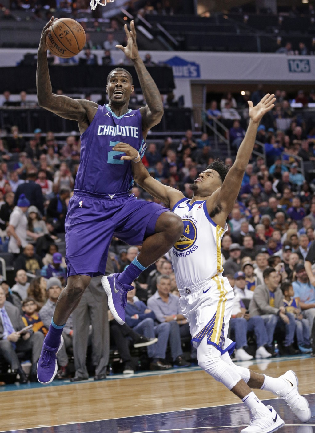 Charlotte Hornets' Marvin Williams (2) drives past Golden State Warriors' Quinn Cook (4) during the first half of an NBA basketball game in Charlotte,