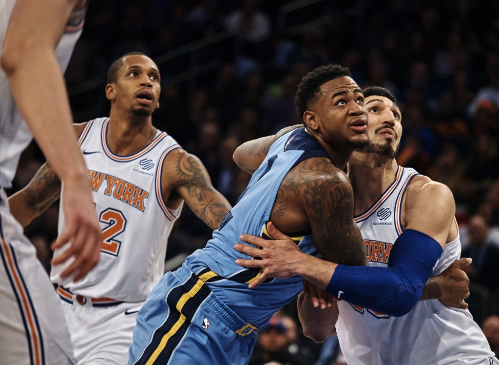 Memphis Grizzlies' Jarell Martin, second right, competes for the ball with New York Knicks' Enes Kanter, right, during the first half of an NBA basket