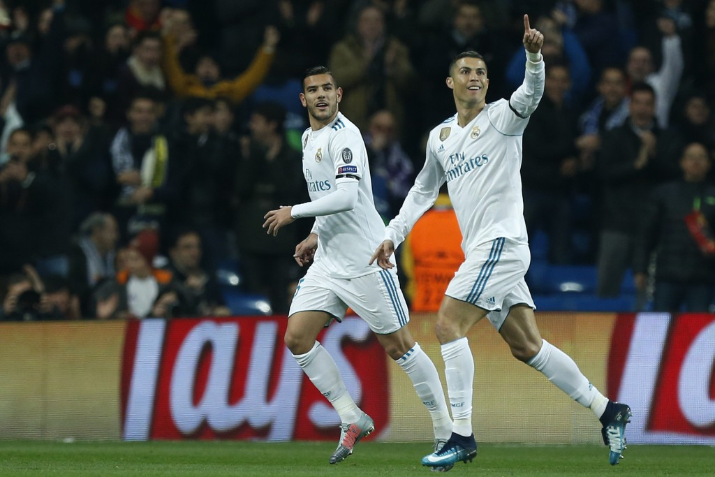 Real Madrid's Cristiano Ronaldo, right, celebrates with team mate Real Madrid's Theo Hernandez after scoring his side's second goal during the Champio