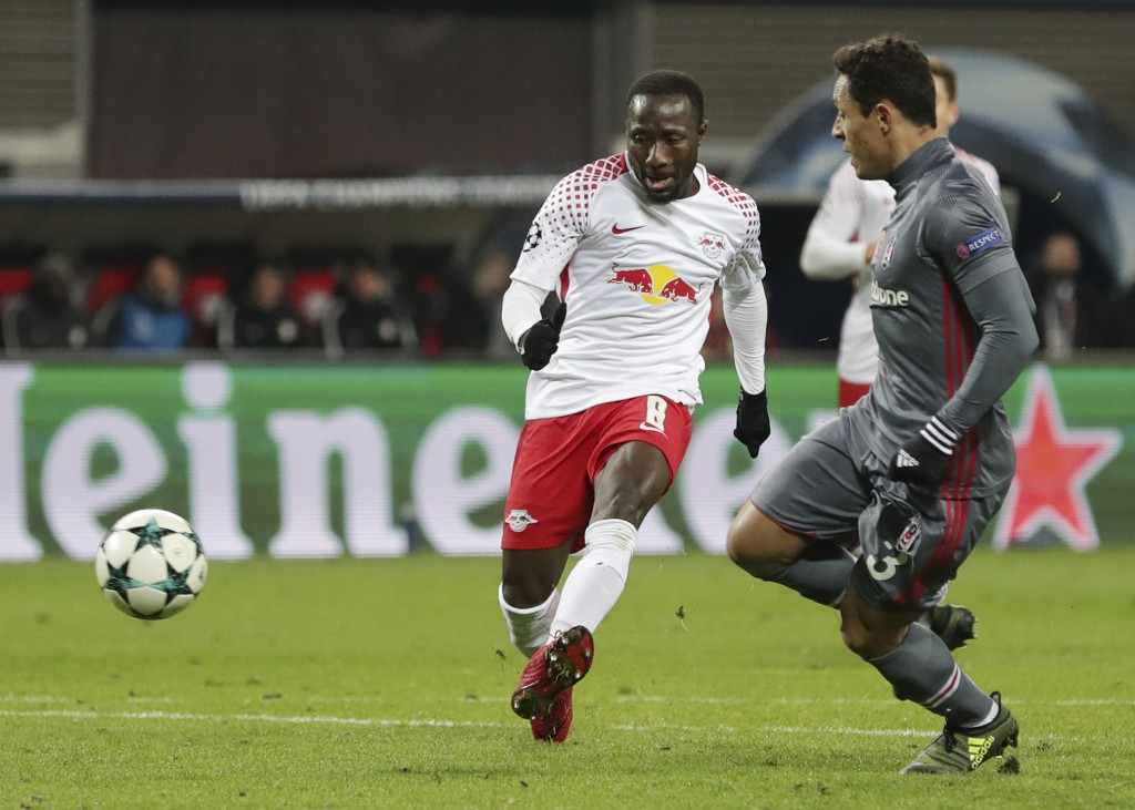 Leipzig's Naby Keita, left, scores his side's opening goal during the Champions League Group G soccer match between RB Leipzig and Besiktas JK in Leip